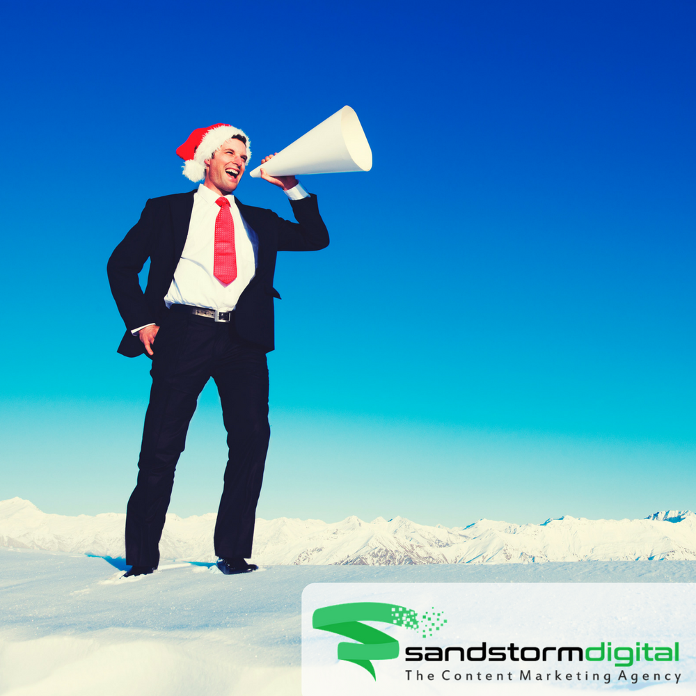 businessman with santa hat and megaphone